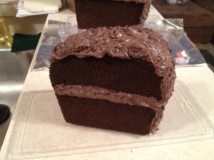 "I used acrylic brown caulk to create a ""layered"" look as well as to create the ""frosting"" on the top and back."
