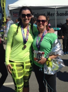 Julie and I after the Rite Aid Cleveland Marathon sporting our beautiful hardware.